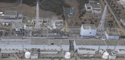Aerial Image of Fukushima showing steam escaping the plant reactor #4