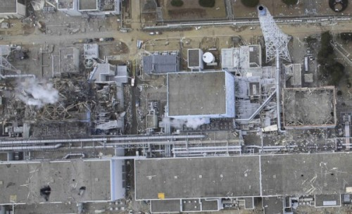 Large Aerial Image of Fukushima showing steam escaping the plant reactor #4